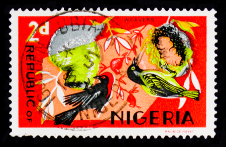 MOSCOW, RUSSIA - OCTOBER 1, 2017: A stamp printed in Nigeria shows Village Weaver (Ploceus cucullatus), Red-headed Malimbe, Fauna serie, circa 1966
