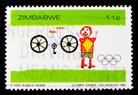 MOSCOW, RUSSIA - OCTOBER 1, 2017: A stamp printed in shows Child paint, bicycle and kid, Olympic Games in Los Angeles, 1984, serie, circa 1984