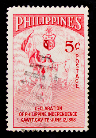 MOSCOW, RUSSIA - OCTOBER 1, 2017: A stamp printed in Philippines shows Liberty with National Flag, Declaration of Philippine Independence serie, circa 1954