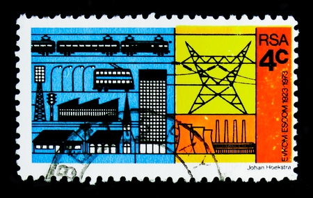 MOSCOW, RUSSIA - OCTOBER 1, 2017: A stamp printed in South Africa shows Electricity consumers and producer, 50th anniversary of ESCOMserie, circa 1973