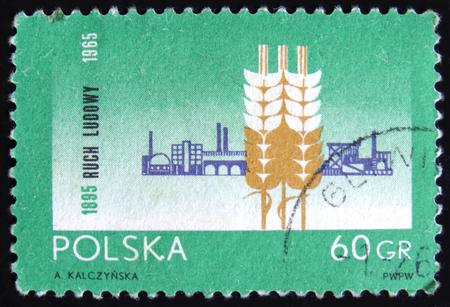 MOSCOW, RUSSIA - APRIL 2, 2017: A post stamp printed in Poland shows wheat and grain storage, dedicated to the 70th Anniversary of the Peasant Movement, circa 1965