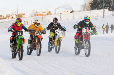 BREKHOVO, MOSCOW REGION, RUSSIA - JANUARY 21, 2017: Unidentified racers of MX2 class ride during Winter open cup of DOSAAF MX Speedway on January 21, 2017
