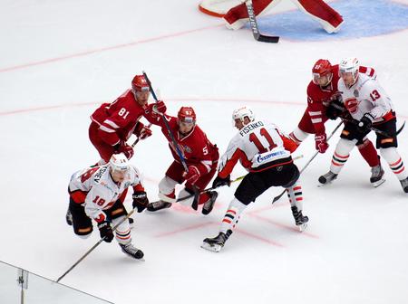 PODOLSK, RUSSIA - SEPTEMBER 3, 2017: A. Shvets-Rogovoy (57) and M. Fisenko (11) on face-off on hockey game Vityaz vs Avangard on 10th Russia KHL championship on September 3, 2017, in Podolsk, Russia. Vityaz won 6:2
