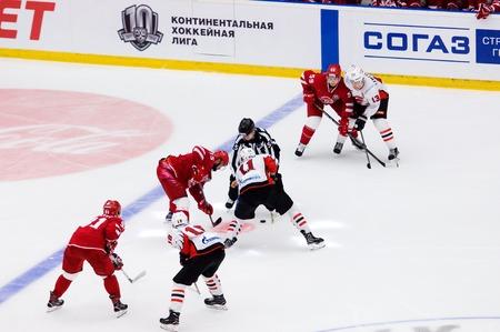 PODOLSK, RUSSIA - SEPTEMBER 3, 2017: R. Horak (15) and M. Fisenko (11) on face-off on hockey game Vityaz vs Avangard on 10th Russia KHL championship on September 3, 2017, in Podolsk, Russia. Vityaz won 6:2