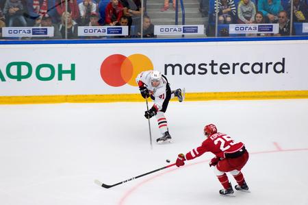 PODOLSK, RUSSIA - SEPTEMBER 3, 2017: M. Mineyev (51) vs A. Kopeikin (25) on hockey game Vityaz vs Avangard on 10th Russia KHL championship on September 3, 2017, in Podolsk, Russia. Vityaz won 6:2