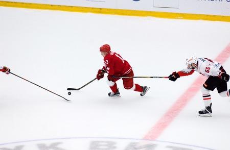PODOLSK, RUSSIA - SEPTEMBER 3, 2017: J. Mankinen (13) dribble on hockey game Vityaz vs Avangard on 10th Russia KHL championship on September 3, 2017, in Podolsk, Russia. Vityaz won 6:2