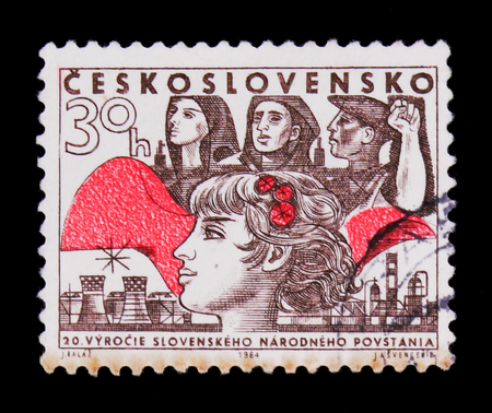 MOSCOW, RUSSIA - JUNE 20, 2017: A stamp printed in Czechoslovakia shows woman with flower, 30 anniversary of rebels, circa 1964