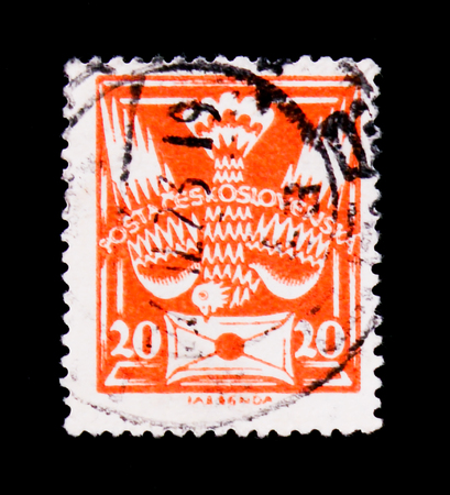 MOSCOW, RUSSIA - JUNE 20, 2017: A stamp printed in Czechoslovakia shows carrier pigeon with letter, circa 1920 Editorial