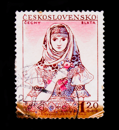 MOSCOW, RUSSIA - JUNE 20, 2017: A stamp printed in Czechoslovakia shows portrait of young woman in Czech national costume, circa 1956