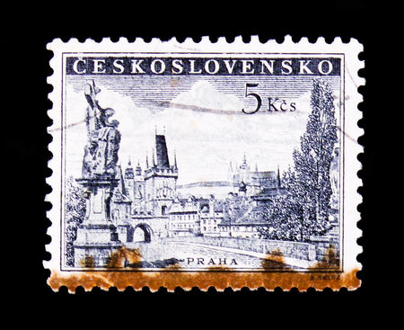 MOSCOW, RUSSIA - JUNE 20, 2017: A stamp printed in Czechoslovakia shows Prague - Charles Bridge, statue of Saint Luitgard by Matthias Braun and Prague Castle, circa 1953