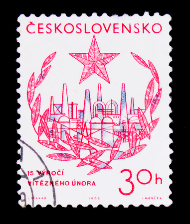 MOSCOW, RUSSIA - JUNE 20, 2017: A stamp printed in Czechoslovakia shows industrial plant, laurel and star, 15th anniversary of victorious February, circa 1963