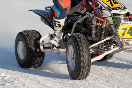 BREKHOVO, MOSCOW REGION, RUSSIA - JANUARY 21, 2017: Wheels of quadcycle during Winter open cup of DOSAAF MX Speedway on January 21, 2017 Editorial