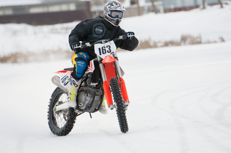 BREKHOVO, MOSCOW REGION, RUSSIA - JANUARY 21, 2017: K. Khvav (163) during Winter open cup of DOSAAF MX Speedway on January 21, 2017 Editorial