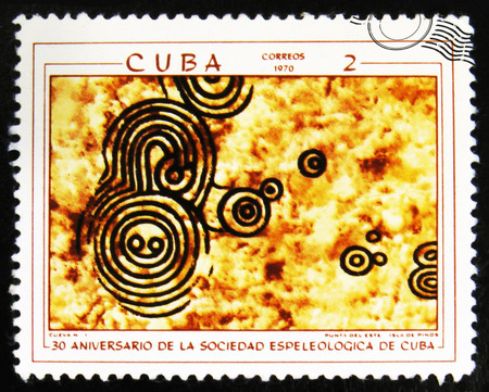 MOSCOW, RUSSIA - JULY 15, 2017: A stamp printed in Cuba shows prehistoric rock paintings, the series The 30th Anniversary of The Cuban Speleological Society, circa 1970 Editorial
