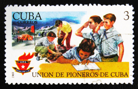 MOSCOW, RUSSIA - JULY 15, 2017: Rare stamp printed in Cuba shows Young students, scouts with inscription The Union of pioneers, circa 1969 Editorial