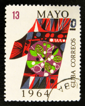 MOSCOW, RUSSIA - JULY 15, 2017: A stamp printed in Cuba shows colorful digit, devoted to Labour day 1st may, circa 1964 Editöryel