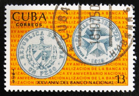 MOSCOW, RUSSIA - JULY 15, 2017: A stamp printed in Cuba shows One peso coin, obverse and reverse, image of a from the series National Bank of Cuba, circa 1975