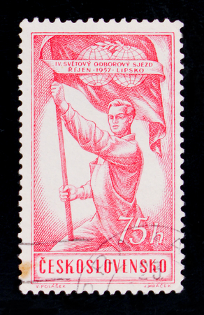 MOSCOW, RUSSIA - JUNE 20, 2017: A stamp printed in Czechoslovakia shows a worker holding a red flag, devoted to the IV World Congress of Trade Unions , circa 1957 Editoriali