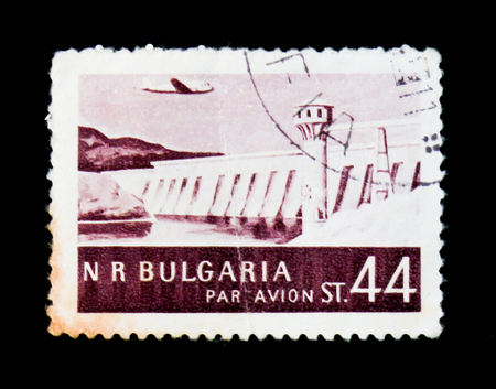 MOSCOW, RUSSIA - JUNE 26, 2017: A stamp printed in Bulgaria shows dam, lighthouse and plane, circa Editorial