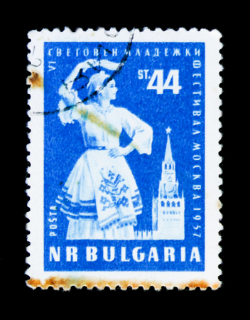 MOSCOW, RUSSIA - JUNE 26, 2017: A stamp printed in Bulgaria show dancing woman, VI festivak of Youth, Moscow-1957, circa 1957