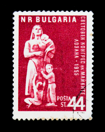 MOSCOW, RUSSIA - JUNE 26, 2017: A stamp printed in Bulgaria shows woman with children, Congress in Lausanne, circa 1955 Editorial