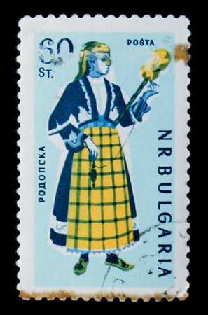 MOSCOW, RUSSIA - JUNE 26, 2017: A stamp printed in Bulgaria shows woman in folk costume Rhodope, circa 1961