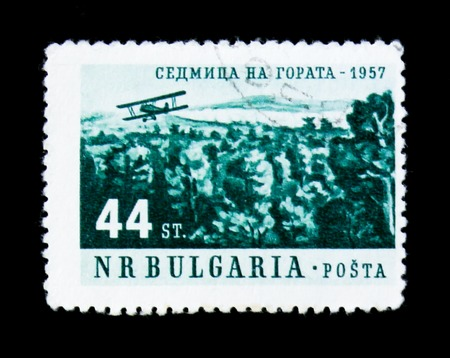 MOSCOW, RUSSIA - JUNE 26, 2017: A stamp printed in Bulgaria shows a plane and forests, a week in forest serie, circa 1957