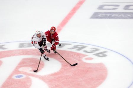 PODOLSK, RUSSIA - SEPTEMBER 3, 2017: E. Mankinen (13) vs A. Petersson (20) on hockey game Vityaz vs Avangard on 10th Russia KHL championship on September 3, 2017, in Podolsk, Russia. Vityaz won 6:2