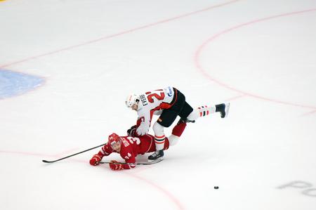 PODOLSK, RUSSIA - SEPTEMBER 3, 2017: D. Everberg (27) fault on N. Burstrom (34) on hockey game Vityaz vs Avangard on 10th Russia KHL championship on September 3, 2017, in Podolsk, Russia. Vityaz won 6:2
