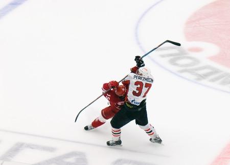 PODOLSK, RUSSIA - SEPTEMBER 3, 2017: A. Perezhogin (37) fault on R. Horak (15) on hockey game Vityaz vs Avangard on 10th Russia KHL championship on September 3, 2017, in Podolsk, Russia. Vityaz won 6:2