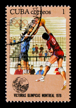 MOSCOW, RUSSIA - JUNE 26, 2017: A stamp printed in Cuba shows volleyball players, series devoted to the Montreal Games 1976, circa 1976