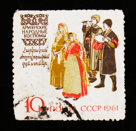 MOSCOW, RUSSIA - JUNE 26, 2017: A stamp printed in USSR (Russia) shows a musicians and dancers in Armenia traditional and historic regional costumes, circa 1961