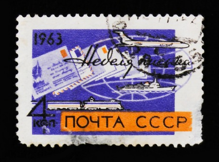 MOSCOW, RUSSIA - JUNE 26, 2017: A stamp printed in USSR (Russia) shows ship, plane and train, A week of letter, circa 1963