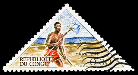 MOSCOW, RUSSIA - SEPTEMBER 3, 2017: A stamp printed in Congo shows postal runner, Ways of mail delivering serie, circa 1961