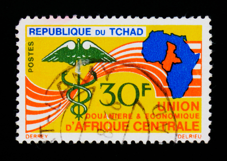 MOSCOW, RUSSIA - SEPTEMBER 3, 2017: A stamp printed in Chad shows map of Africa, Health organization emblem, circa 1966