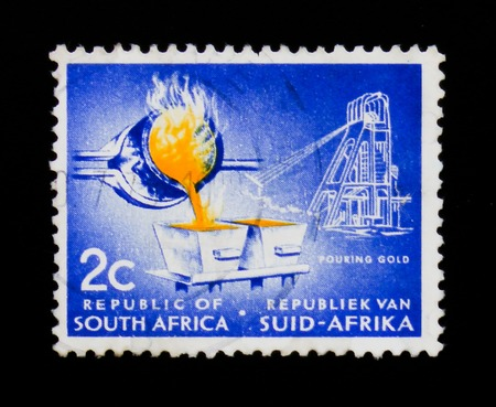 MOSCOW, RUSSIA - SEPTEMBER 3, 2017: A stamp printed in South Africa shows Gold pouring, Definitive Issue - Decimal Issue serie, circa 1961 에디토리얼