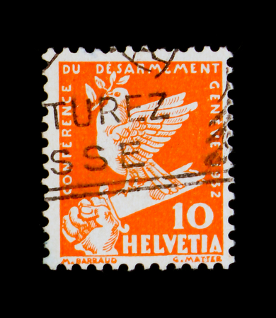MOSCOW, RUSSIA - SEPTEMBER 3, 2017: A stamp printed in Switzerland shows Peace dove on a broken sword, Disarmenent conference serie, circa 1932
