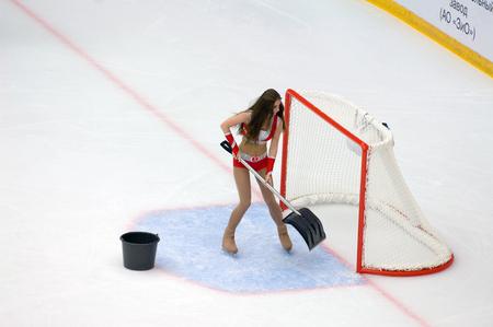 PODOLSK, RUSSIA - SEPTEMBER 10, 2017: Cheerleader girl clean up the gate on hockey game Vityaz vs Barys on 10th Russia KHL championship on September 10, 2017, in Podolsk, Russia. Vityaz won 5:1