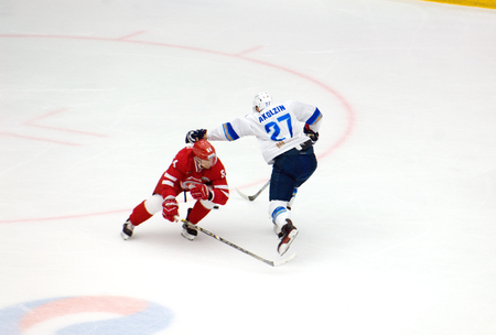 PODOLSK, RUSSIA - SEPTEMBER 10, 2017: S. Romanov (64) vs P. Akolzin (27) on hockey game Vityaz vs Barys on 10th Russia KHL championship on September 10, 2017, in Podolsk, Russia. Vityaz won 5:1 Redakční