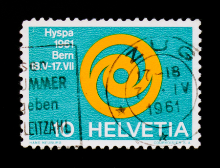 MOSCOW, RUSSIA - SEPTEMBER 3, 2017: A stamp printed in Switzerland shows Emblem of Exhibition HYSPA 1961, Hyspa serie, circa 1961 Editorial