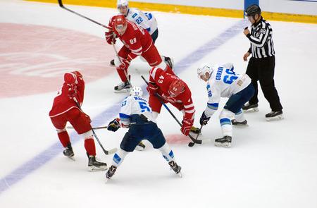 PODOLSK, RUSSIA - SEPTEMBER 10, 2017: D. Gurkov (68) vs I. Petrakov (43) on face-off on hockey game Vityaz vs Barys on 10th Russia KHL championship on September 10, 2017, in Podolsk, Russia. Vityaz won 5:1