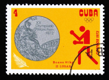 MOSCOW, RUSSIA - JUNE 26, 2017: A stamp printed in Cuba a picture of a boxing, with the inscription Boxing, 81 kg from the series XX Summer Olympic Games, Munich, 1972, circa 1973