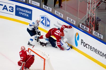 PODOLSK, RUSSIA - SEPTEMBER 10, 2017: Y. Pautov (81) and P. Akolzin (27) fall down on hockey game Vityaz vs Barys on 10th Russia KHL championship on September 10, 2017, in Podolsk, Russia. Vityaz won 5:1 에디토리얼