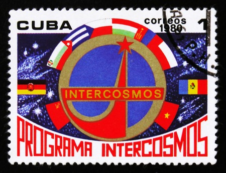 MOSCOW, RUSSIA - JUNE 26, 2017: A stamp printed in Cuba shows Emblem and flags, Space Program of the Soviet Union, Intercosmos, circa 1980