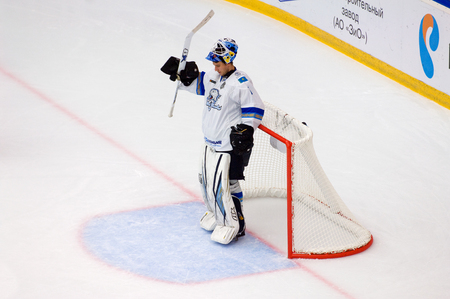 PODOLSK, RUSSIA - SEPTEMBER 10, 2017: Goalkeeper H, Karlsson (1) resting on hockey game Vityaz vs Barys on 10th Russia KHL championship on September 10, 2017, in Podolsk, Russia. Vityaz won 5:1