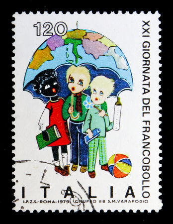 MOSCOW, RUSSIA - MAY 10, 2018: A stamp printed in Italy shows Children under the umbrella, devoted to Stamp Day, serie, circa 1979 Editorial