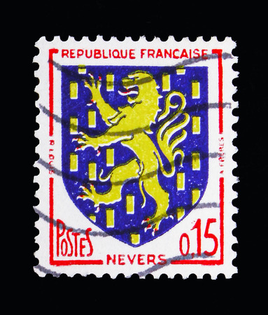 MOSCOW, RUSSIA - MAY 10, 2018: A stamp printed in France shows Nevers, Coat of Arms serie, circa 1962