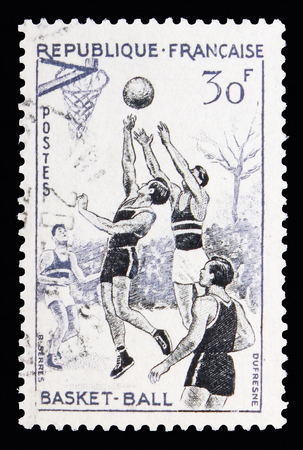 MOSCOW, RUSSIA - MAY 10, 2018: A stamp printed in France shows Basketball, Sports serie, circa 1956 Editorial