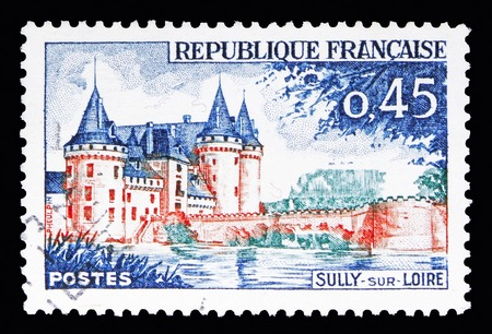 MOSCOW, RUSSIA - MAY 10, 2018: A stamp printed in France shows Sully-sur-Loire, Tourism serie, circa 1961