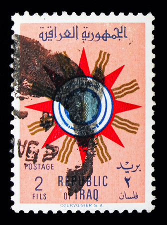 MOSCOW, RUSSIA - MAY 10, 2018: A stamp printed in Iraq shows Coat of arms of the Republic, serie, circa 1959
